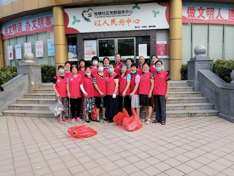 红马甲彰显志愿美,环境清洁美家园